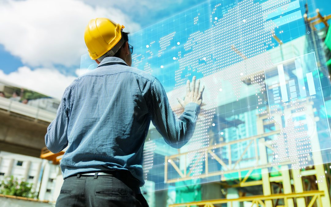 smart asian engineer manager with safety uniform checking site construction with steel and concrete structure background with virtual monitor screen system control