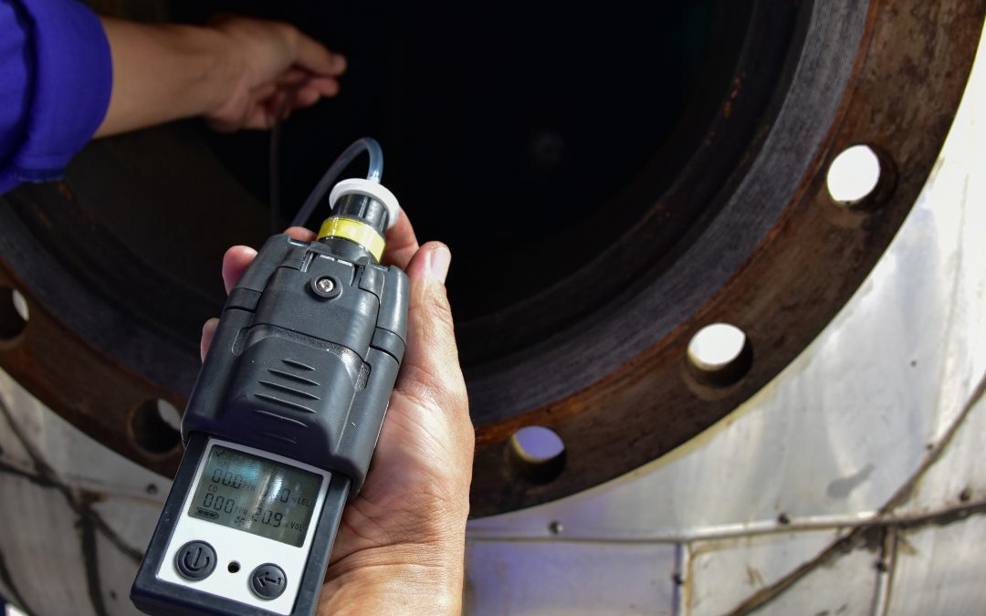 Human using the gas detector for detect combustible gas
